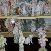 Bisue  figures  over  100 yrs  old